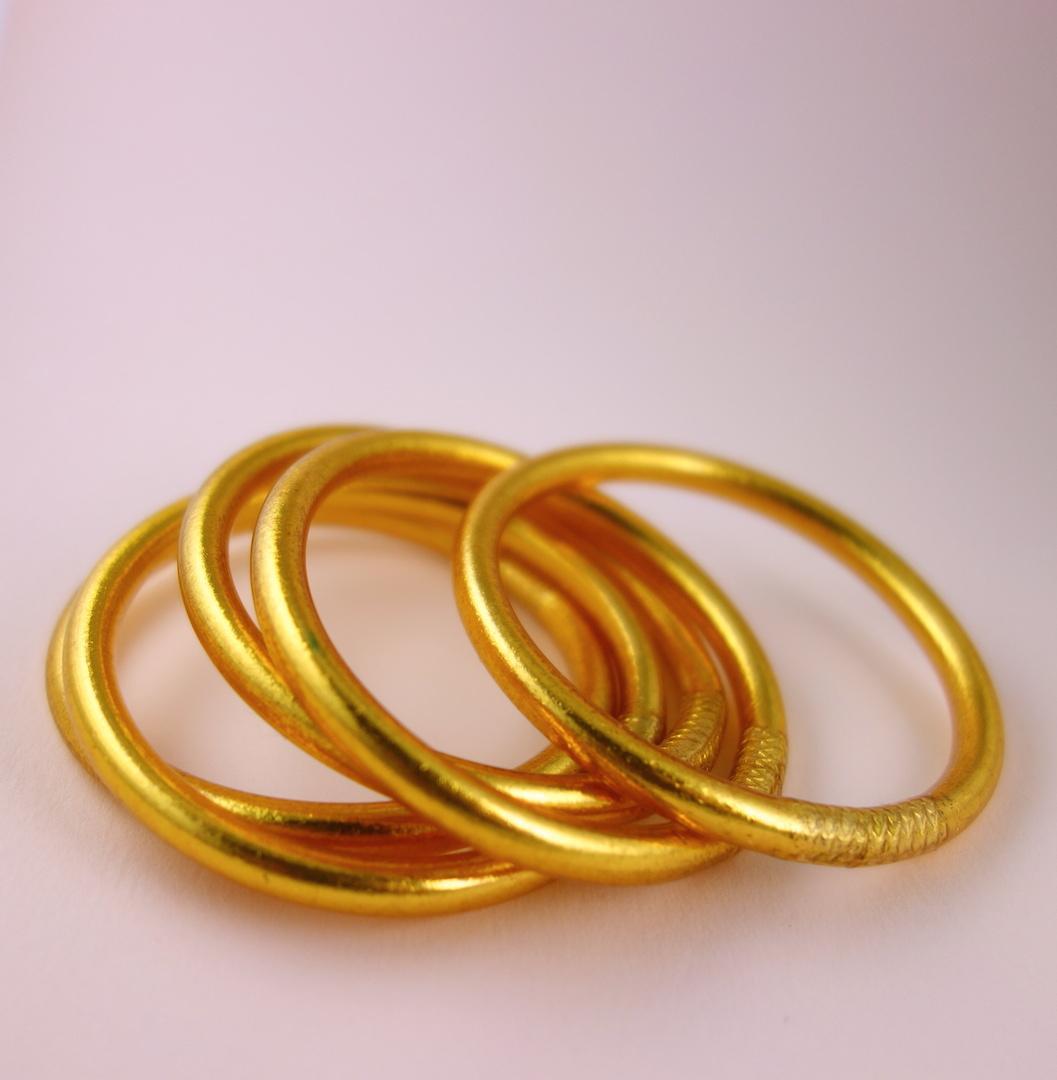 Bracelet jonc de temple bouddhiste en poudre d'or et caoutchouc