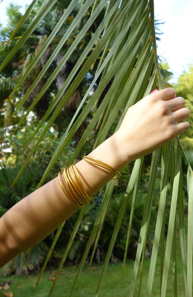 Bracelet jonc de temple fin bouddhiste en poudre d'or et caoutchouc